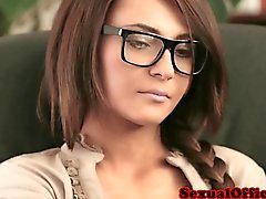 Beautiful secretary with glasses pounded on desk