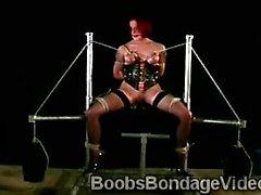 Redhead hottie enjoys a painful boobs bondage torture