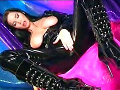 Latex bitch fingering her hole