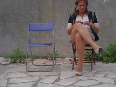 Nadejda smoke an cigarette on her chair ...