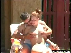 This sexy redhead milf is eaten out and fucked in the pool