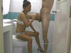 Thai Hooker Sucks Cock in the Toilet