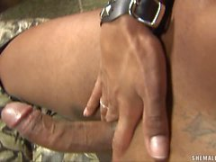 Busty hot shemale in leather outfit plays with her big cum shooter
