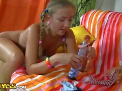 Blonde with pigtails began to play with a pink dildo