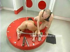 Leather whip touches round ass spanking him and preparing slut for a fetish submission sex