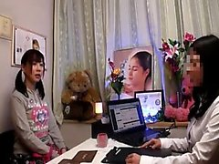 Young Asian cutie with tiny tits changes into a robe for a