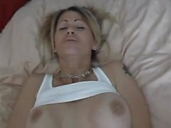 Tattooed blonde wife with big hooters feeds her passion for anal sex