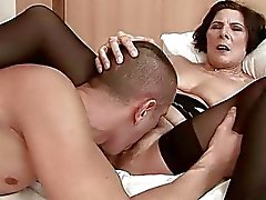 Hairy granny in black stockings gets fucked