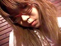 Nerdy Oriental schoolgirl bringing herself to pleasure with
