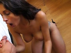 A Beautiful Brunette Gets On Her Knees To Suck Cock