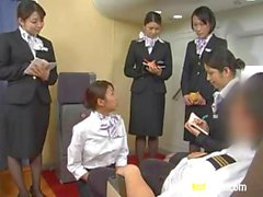 Asian stewardess goes down on a small cock in front of a crowd