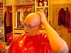 Bald and smoking in rubber cape