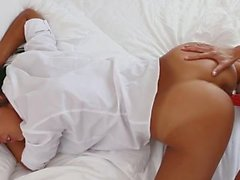 Bent over brunette fucked with strapon dildo in bed