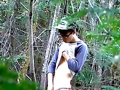 Nature loving twink Sacha West works a load among the trees