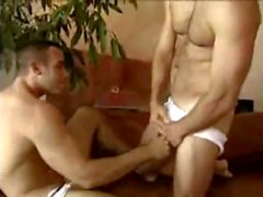 Two incredibly hot men stroke and frot on a couch
