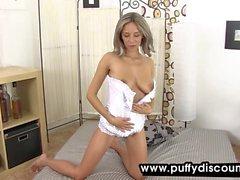 Flexible hottie in corset plays with her twat