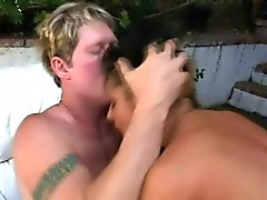Striking brunette with big boobs reaches her climax between two cocks