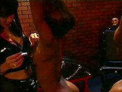 a lady plays with her slave girls