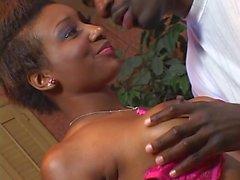 Ebony slut with pert boobs sucks meaty black boner then gets fucked for tit cum