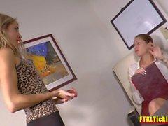 Brunette boss makes her blonde secretary worship her sexy feet