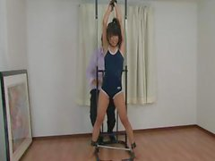 Skinny petite Japanese babe gets tied up and put through pleasure and pain