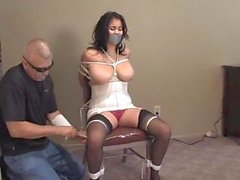 Busty girl tape gagged and tied to a chair