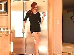 Elle beautiful redhead with top on toying pussy with glass dildo on kitchen table