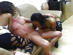 Black ebony threesome sucking him off