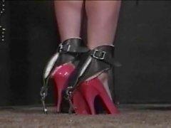 Mistress spanks tied girl