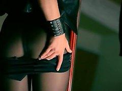 Mysterious woman masturbates with dildo
