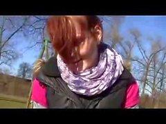 Young redhead outdoor handjob