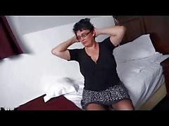 Chubby mature brunette strips and masturbates on bed