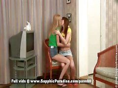 Bethany and Agathe blonde and redhead lesbians kissing and undressing in the living room