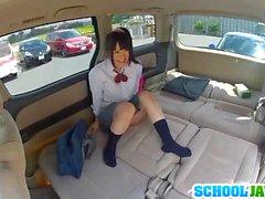 Japanese schoolgirl enjoys sex in a car