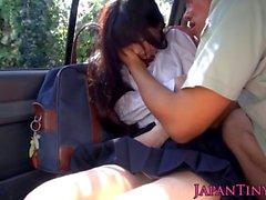 Japanese schoolgirl blowing cock in the car