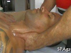Mature masseur rubs down a hot black stud