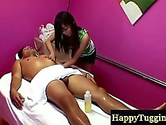 Asian masseur tugs her clients cock