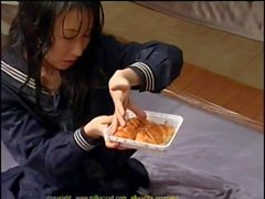 Doting Asian cowgirl in uniform enjoys nut buttered snacks after a bukkake party