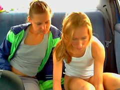 two girl play in car