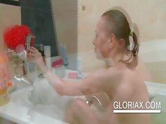 Cute Gloria getting her tight cunt wet in bathtub
