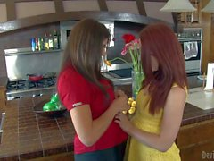 Raylene and Melody Jordan lick each other in kitchen
