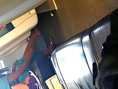 Indian woman barefoot shoe change on train