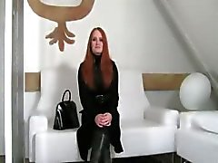 Redhead enjoying coitus on white divan