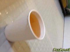 Japanese teens pee in cup