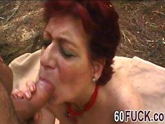 Slutty redhead granny big cock outdoor blowjob