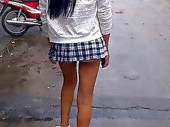 Lovely ladyboy in school uniform walk to meet ladyboy friend