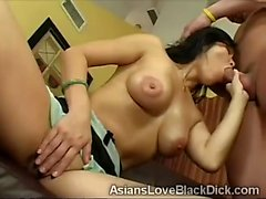Big tits Asian beauty kneels to devour a huge cock