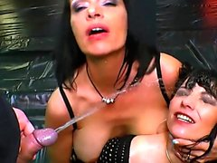 Two German Moms get their Big tits covered in Piss