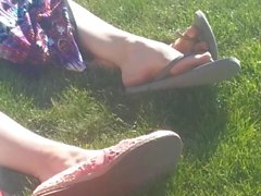 Candid Feet in Flip Flops on the Lawn
