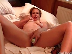 Blonde MILF relaxes before toying with her clit